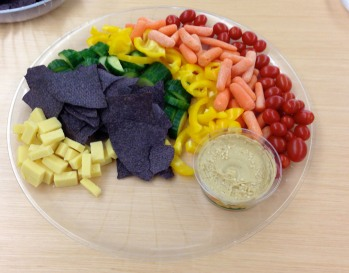 "Veggie and Tortilla Chip Rainbow with a ""cloud"" of Irish Cheddar and a ""Pot O' Gold Hummus"""